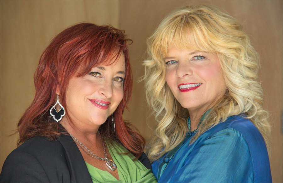 L-R: Wives Karen Paull and Wendy Robbins